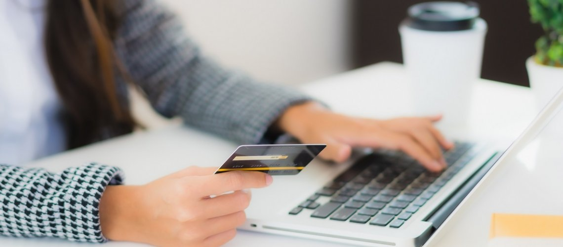 Portrait beautiful young asian woman use credit card with laptop for online shopping item